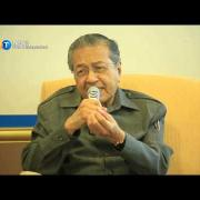 Stop the violence, Mahathir tells Muslims